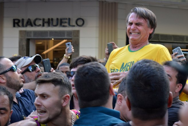 Brazilian presidential candidate Jair Bolsonaro reacts after being stabbed during a rally in Juiz de Fora